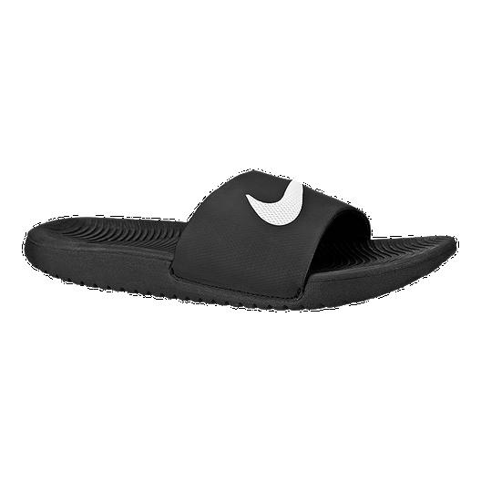 57ac3463236f Nike Kids  Kawa Slide Sandals - Black White