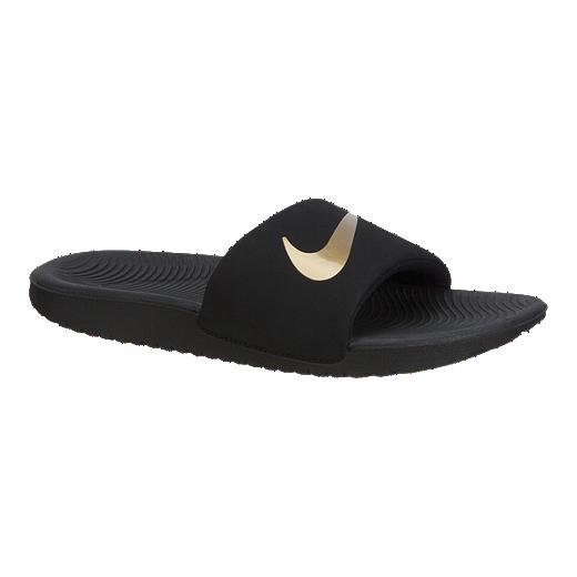 buy popular 833e0 77142 Nike Girls  Kawa Slides - Black Gold - BLACK METALLIC-GOLD