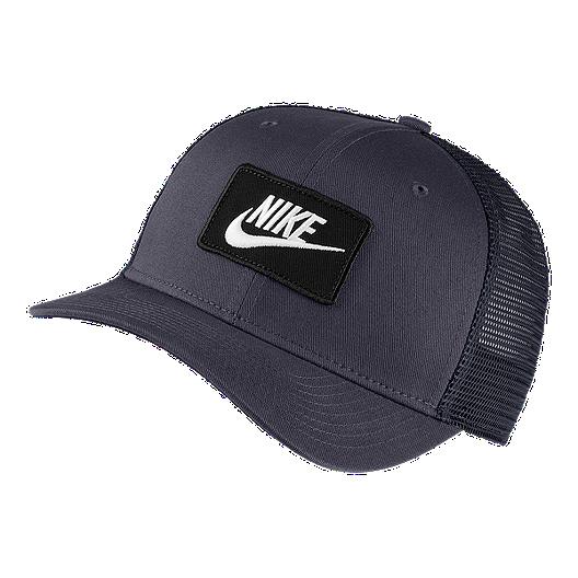 85b543c2ba2 Nike Men s Nike Sports Wear Trucker Hat
