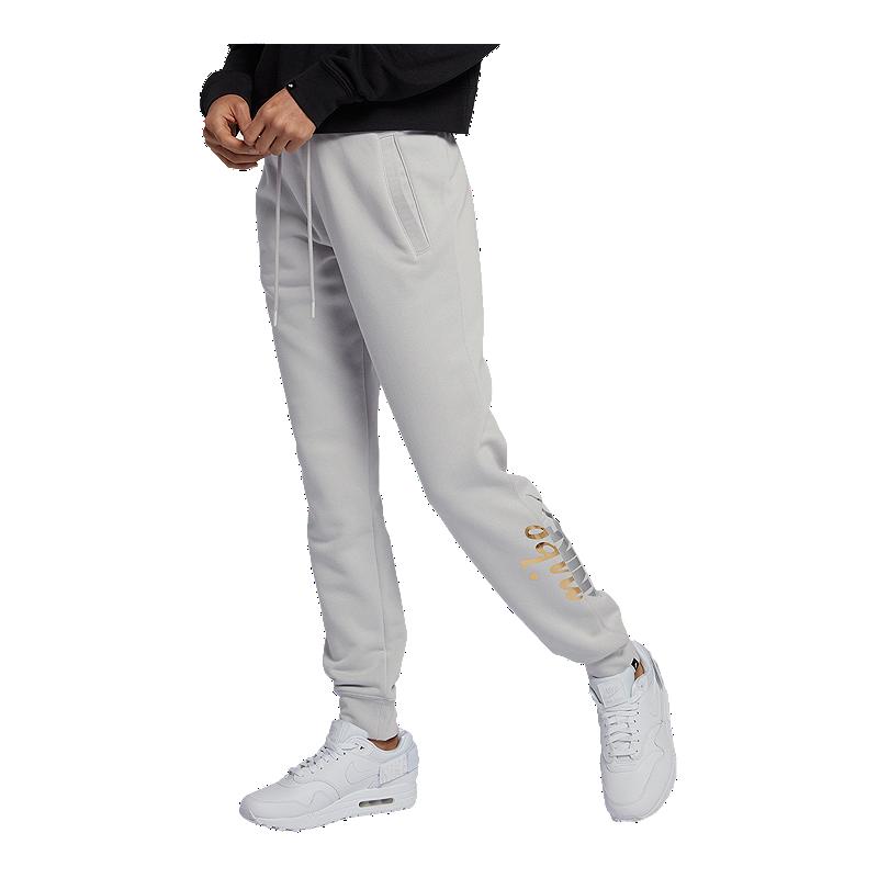 d7da9e8fa3af Nike Sportswear Women s Rally Metallic Pants
