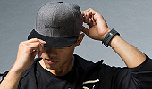 Man wearing accessories like a hat and fitbit